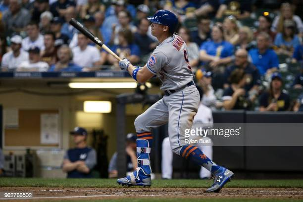Brandon Nimmo of the New York Mets hits a double in the fifth inning against the Milwaukee Brewers at Miller Park on May 24 2018 in Milwaukee...