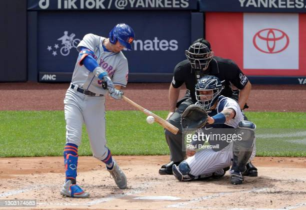 August 30: Brandon Nimmo of the New York Mets hits a long fly ball in game 1 of an interleague MLB baseball doubleheader as catcher Gary Sanchez of...