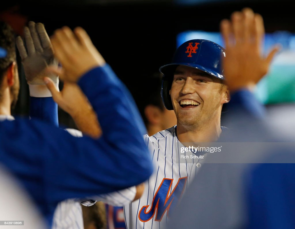 Brandon Nimmo #9 of the New York Mets is congratulated after he hit a two-run home run, his second of the game against the Cincinnati Reds during the sixth inning of a game at Citi Field on September 7, 2017 in the Flushing neighborhood of the Queens borough of New York City.