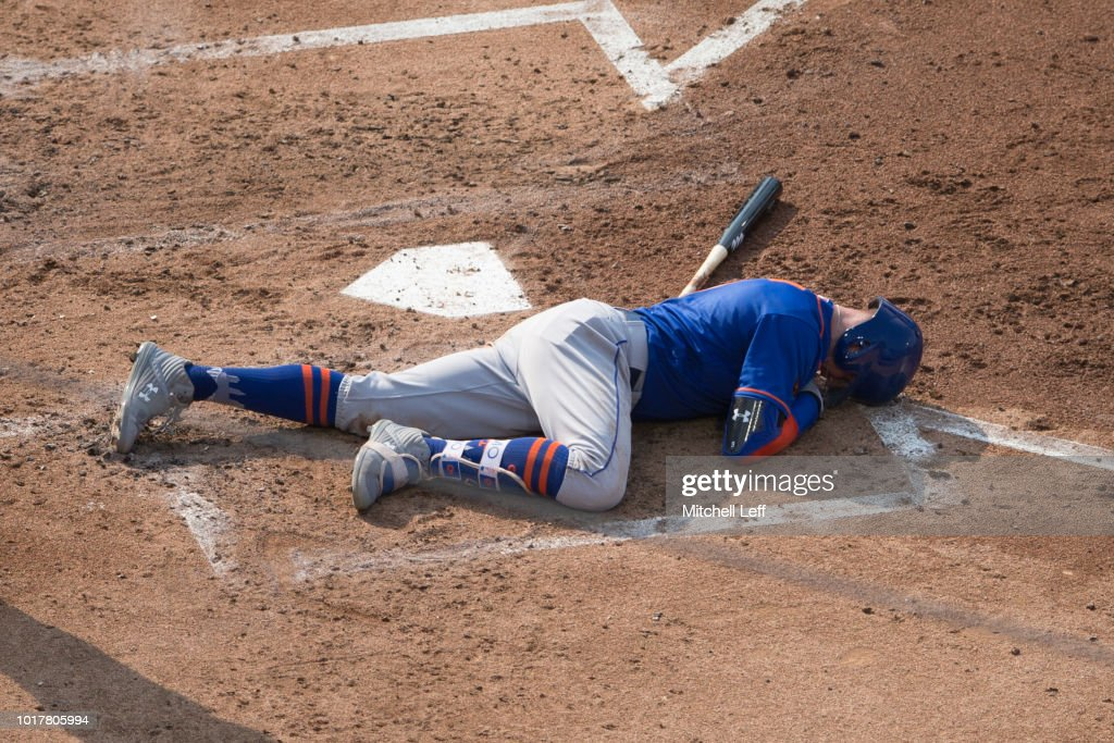 Brandon Nimmo #9 of the New York Mets lays on the ground after in injury in the top of the third inning against the Philadelphia Phillies in game one of the doubleheader at Citizens Bank Park on August 16, 2018 in Philadelphia, Pennsylvania.