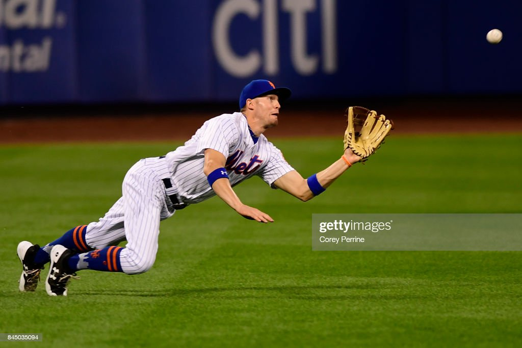 Brandon Nimmo #9 of the New York Mets lays out in left field to catch an out during the first inning against the Cincinnati Reds at Citi Field on September 9, 2017 in the Flushing neighborhood of the Queens borough of New York City.