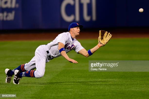 Brandon Nimmo of the New York Mets lays out in left field to catch an out during the first inning against the Cincinnati Reds at Citi Field on...