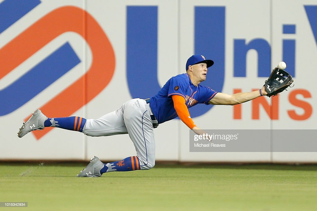 Brandon Nimmo #9 of the New York Mets makes a diving catch against the Miami Marlins in the sixth inning at Marlins Park on August 11, 2018 in Miami, Florida.