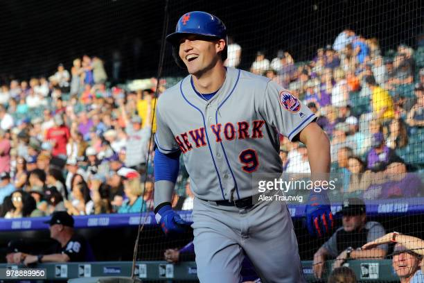 Brandon Nimmo of the New York Mets reacts after hitting an inside the park home run in the first inning during a game against the Colorado Rockies at...
