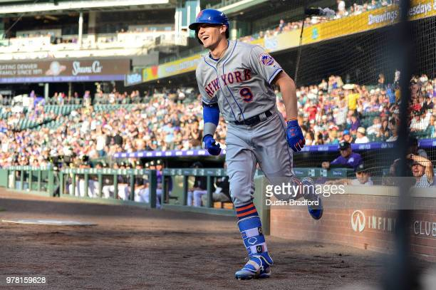 Brandon Nimmo of the New York Mets smiles as he celebrates after scoring on a first inning insidethepark homerun against the Colorado Rockies at...