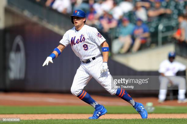 Brandon Nimmo of the New York Mets takes a lead off first base during the game against the Atlanta Braves at Citi Field on Thursday May 3 2018 in the...