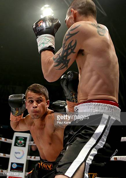 Brandon Ogilvie of Perth and Alex Ah Tong of Sydney fight during the Light Welterweight bout at Metro City on July 6 2013 in Perth Australia