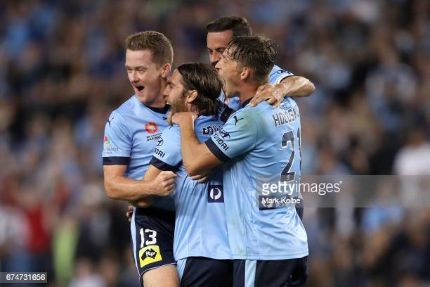Brandon O'Neill Joshua Brillante Alex Brosque and Filip Holosko of Sydney FC celebrate Joshua Brillante scoring a goal during the ALeague Semi Final...