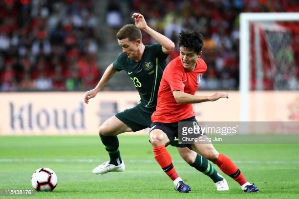 Brandon O'Neill of Australia and Hwang Inbeom of South Korea compete for the ball during the international friendly match between South Korea and...