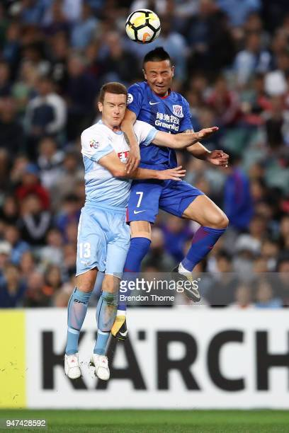 Brandon O'Neill of Sydney competes with Mao Jianqing of Shanghai Shenhua FC during the AFC Champions League match between Sydney FC and Shaghai...