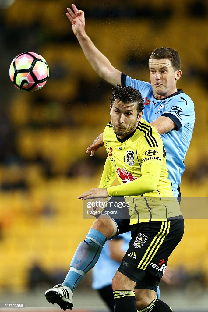 Brandon O'Neill of Sydney FC and Vince Lia of the Phoenix compete for a header during the round three A-League match between the Wellington Phoenix and Sydney FC at Westpac Stadium on October 23, 2016 in Wellington, New Zealand.