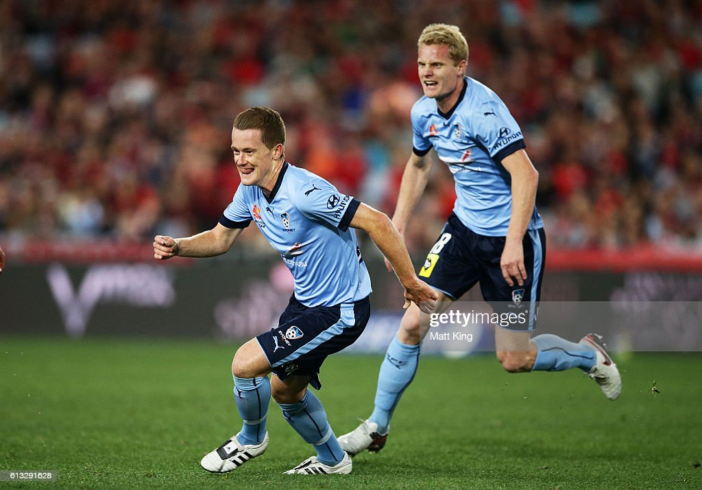 Brandon O'Neill of Sydney FC celebrates with team mates after scoring a goal during the round one A-League match between the Western Sydney Wanderers and Sydney FC at ANZ Stadium on October 8, 2016 in Sydney, Australia.