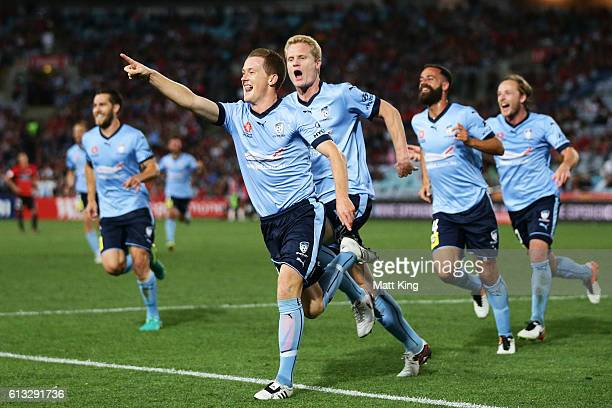 Brandon O'Neill of Sydney FC celebrates with team mates after scoring a goal during the round one ALeague match between the Western Sydney Wanderers...