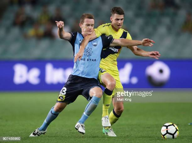 Brandon O'Neill of Sydney FC competes for the ball against Jake McGing of the Mariners during the round 17 ALeague match between Sydney FC and the...