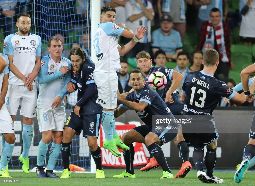 Brandon O'Neill (R) of Sydney FC shoots and scores their second goal during the round 21 A-League match between Melbourne City and Sydney FC at AAMI Park on February 24, 2017 in Melbourne, Australia.
