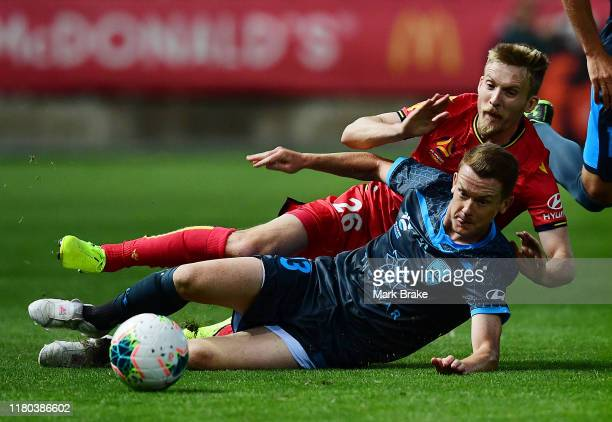 Brandon O'Neill of Sydney FC tackles Ben Halloran of Adelaide United during the round one A-League match between Adelaide United and Sydney FC at...