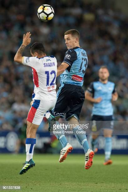 Brandon O'Neill of Sydney FC takes a header over Jets Mario Shabow during the round fourteen ALeague match between the Sydney FC and Newcastle Jets...