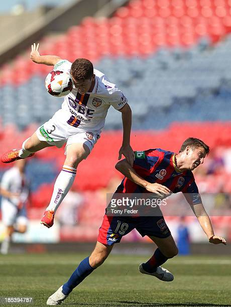 Brandon O'Neill of the Glory heading the ball in front of Michael Bridges of the Jets during the round two ALeague match between the Newcastle Jets...