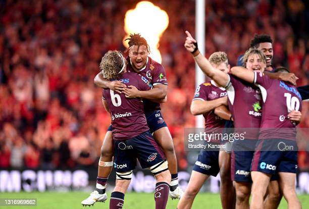 Brandon Paenga-Amosa and Angus Scott-Young of the Reds celebrate victory after the Super RugbyAU Final match between the Queensland Reds and the ACT...