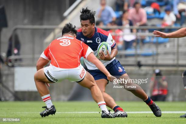 Brandon Paenga-Amosa of the Reds takes on Takuma Asahara of the Sunwolves during the Super Rugby match between Sunwolves and Reds at Prince Chichibu...