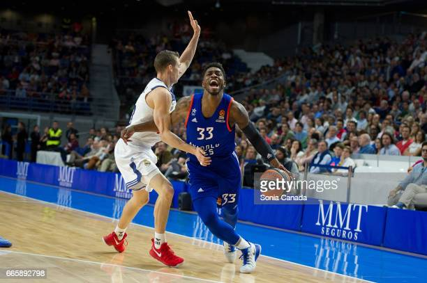Brandon Paul #33 guard of Anadolu Efes and Jaycee Carroll #20 guard of Real Madrid during the 2016/2017 Turkish Airlines Euroleague Regular Season...