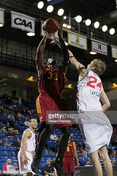 Brandon Paul of the Canton Charge shoots against Joonas Caven of the Delaware 87ers at the University of Delaware Bob Carpenter Center on February 24...
