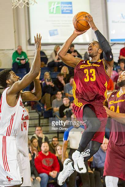 Brandon Paul of the Canton Charge slashes to the hoop for a shot over Omari Johnson of the Maine Red Claws on December 28 2014 at the Portland Expo...