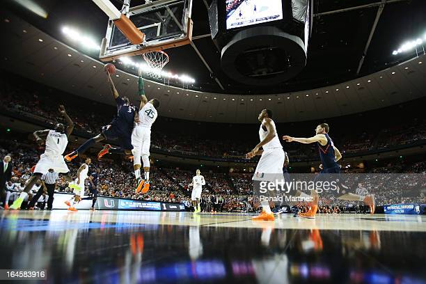 Brandon Paul of the Illinois Fighting Illini goes up against Julian Gamble of the Miami Hurricanes in the first half during the third round of the...