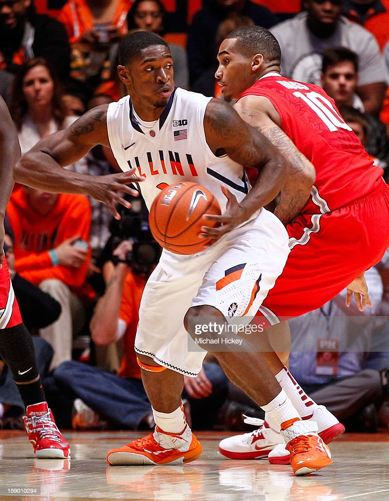 Brandon Paul #3 of the Illinois Fighting Illini looks to pass off the ball as LaQuinton Ross #10 of the Ohio State Buckeyes defends at Assembly Hall on January 5, 2013 in Champaign, Illinois. Ilinois defeated Ohio State 74-55.