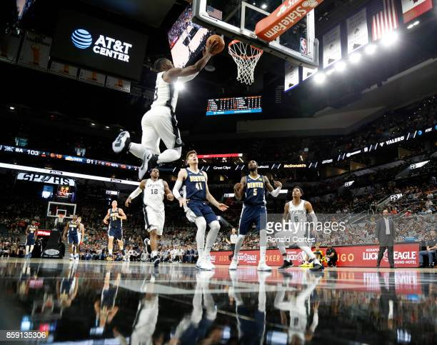 Brandon Paul of the San Antonio Spurs drives for for two against the Denver Nuggets at ATT Center on October 8 2017 in San Antonio Texas NOTE TO USER...