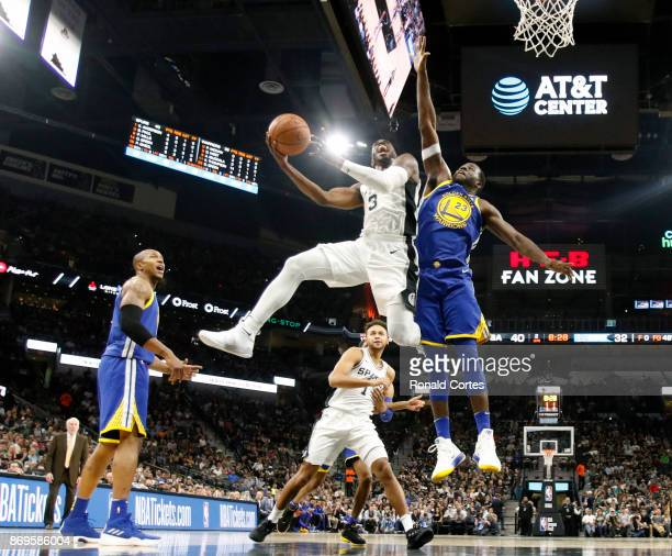 Brandon Paul of the San Antonio Spurs drives past Draymond Green of the Golden State Warriors at ATT Center on November 2 2017 in San Antonio Texas...