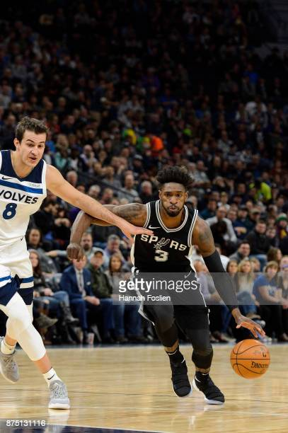 Brandon Paul of the San Antonio Spurs drives to the basket against Nemanja Bjelica of the Minnesota Timberwolves during the game on November 15 2017...