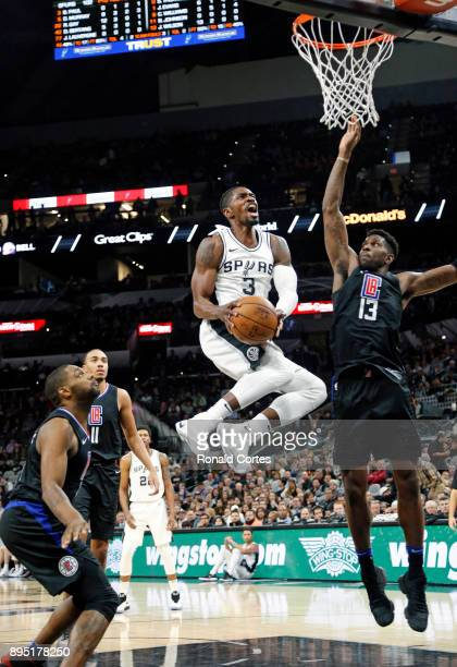 Brandon Paul of the San Antonio Spurs drives to the basket against Jamil Wilson of the Los Angeles Clippers at ATT Center on December 18 2017 in San...