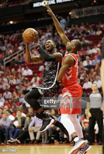 Brandon Paul of the San Antonio Spurs drives to the basket on Luc Mbah a Moute of the Houston Rockets at Toyota Center on March 12 2018 in Houston...