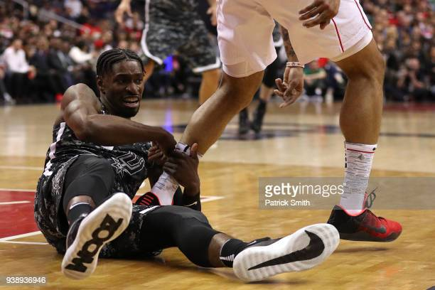 Brandon Paul of the San Antonio Spurs grabs a Washington Wizards players leg during the second half at Capital One Arena on March 27 2018 in...