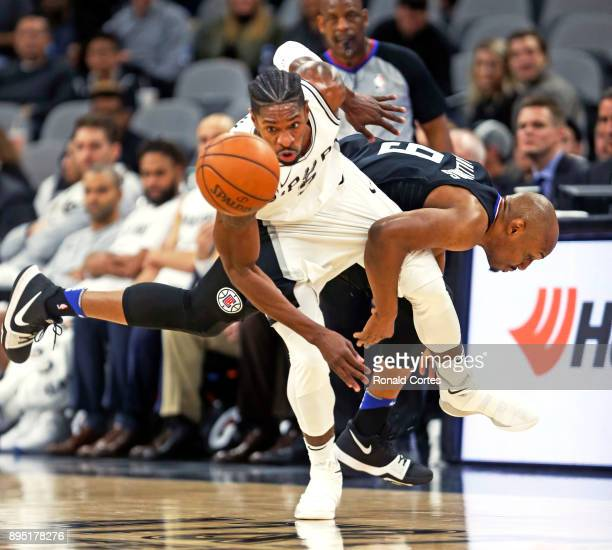 Brandon Paul of the San Antonio Spurs steals the ball from CJ Williams of the Los Angeles Clippers at ATT Center on December 18 2017 in San Antonio...