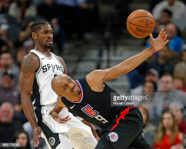 Brandon Paul of the San Antonio Spurs watches CJ Williams of the Los Angeles Clippers lose control of the ball at ATT Center on December 18 2017 in...