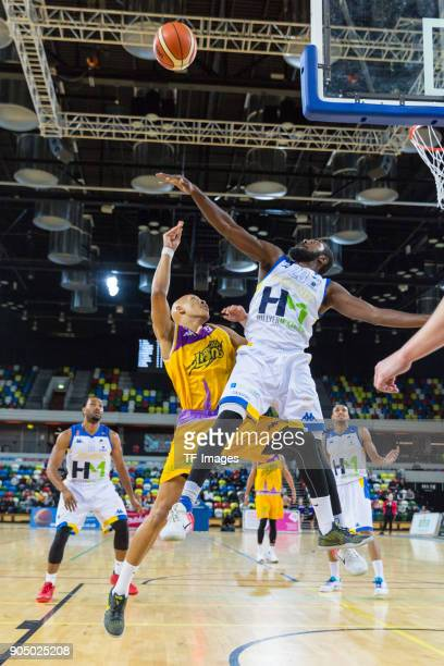 Brandon Peel of London Lions is stopped by the defense of Cheshire Phoenix during the British Basketball League match between London Lions and...
