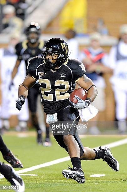 Brandon Pendergrass of the Wake Forest Demon Deacon rushes the ball against the Maryland Terrapins at BB&T Field on October 10, 2009 in Winston...