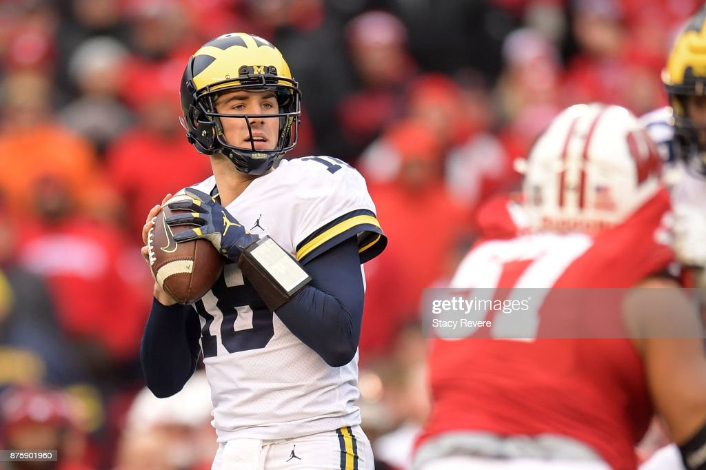 Brandon Peters #18 of the Michigan Wolverines drops back to pass during the third quarter of a game against the Wisconsin Badgers at Camp Randall Stadium on November 18, 2017 in Madison, Wisconsin.
