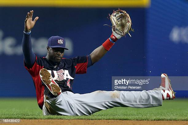 Brandon Phillips of Team USA reacts after throwing a diving ground ball out in the in the sixth inning against Team Italy during the World Baseball...
