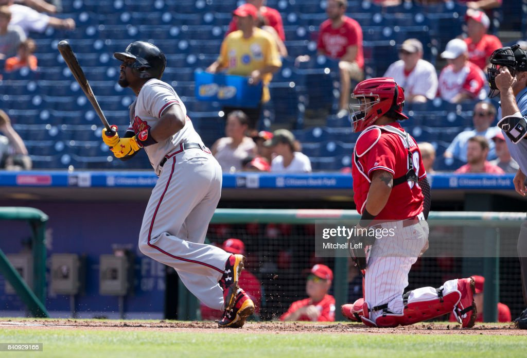 Brandon Phillips #4 of the Atlanta Braves hits an RBI single for his 2,000 career hit in the top of the first inning against the Philadelphia Phillies in game one of the doubleheader at Citizens Bank Park on August 30, 2017 in Philadelphia, Pennsylvania.