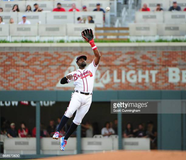 Brandon Phillips of the Atlanta Braves makes a leaping catch of a second inning liner against the San Diego Padres at SunTrust Park on April 15 2017...