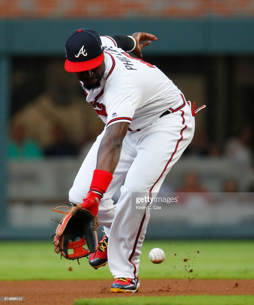 Brandon Phillips #4 of the Atlanta Braves scoops up a grounder hit by David Peralta #6 of the Arizona Diamondbacks and turns a double play in the first inning at SunTrust Park on July 14, 2017 in Atlanta, Georgia.