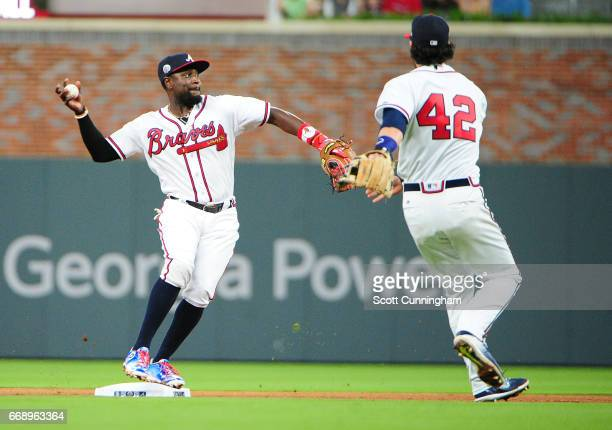 Brandon Phillips of the Atlanta Braves takes a throw barehanded from Dansby Swanson to complete a seventh inning double play against the San Diego...