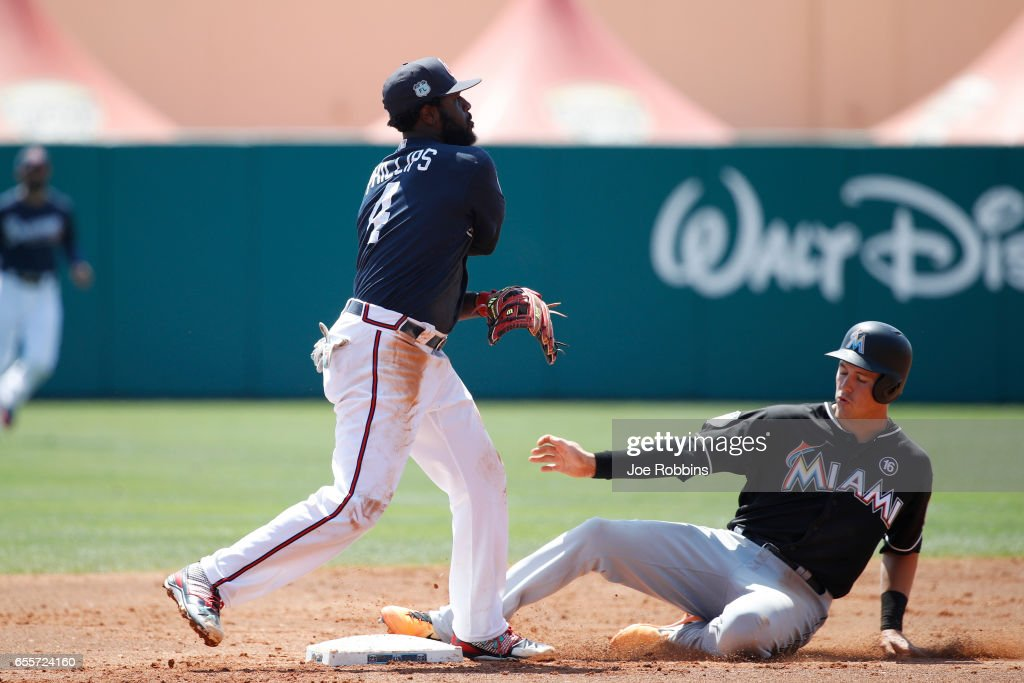 Brandon Phillips #4 of the Atlanta Braves turns a double play ahead of the sliding Brian Anderson #87 of the Miami Marlins in the second inning of a Grapefruit League spring training game at Champion Stadium on March 20, 2017 in Lake Buena Vista, Florida. The Marlins defeated the Braves 9-3.