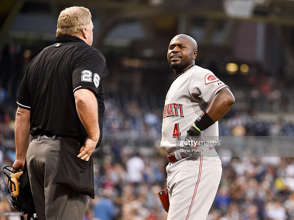 Brandon Phillips #4 of the Cincinnati Reds argues with home plate umpire Bill Miller after striking out during the third inning of a baseball game against the San Diego Padres at Petco Park July 1, 2014 in San Diego, California.