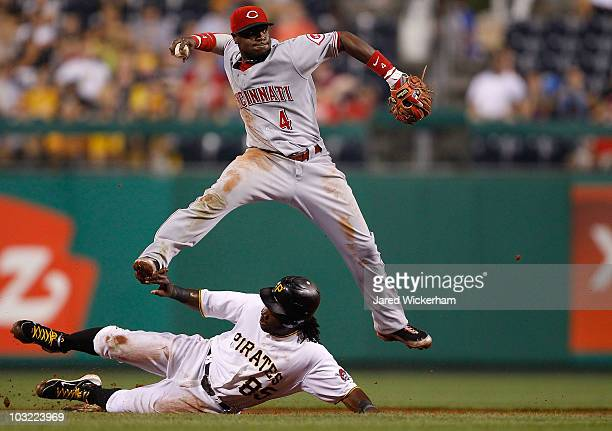 Brandon Phillips of the Cincinnati Reds attempts to turn the double play over Lastings Milledge of the Pittsburgh Pirates during the game on August 3...
