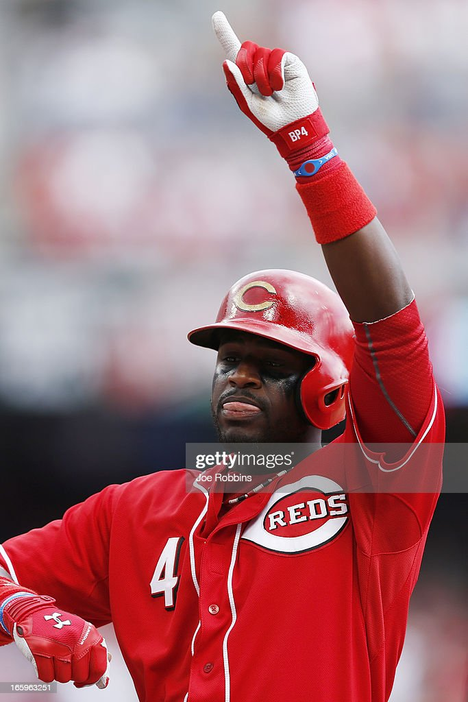 Brandon Phillips #4 of the Cincinnati Reds celebrates after driving in a run in the sixth inning of the game against the Washington Nationals at Great American Ball Park on April 7, 2013 in Cincinnati, Ohio. The Reds won 6-3.