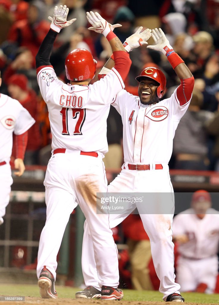 Brandon Phillips #4 of the Cincinnati Reds celebrates with Shin-Soo Choo #17 after Choo scored the winning run in the 9th inning against the Los Angeles Angels of Anaheim at Great American Ball Park on April 3, 2013 in Cincinnati, Ohio. The Reds won 5-4.
